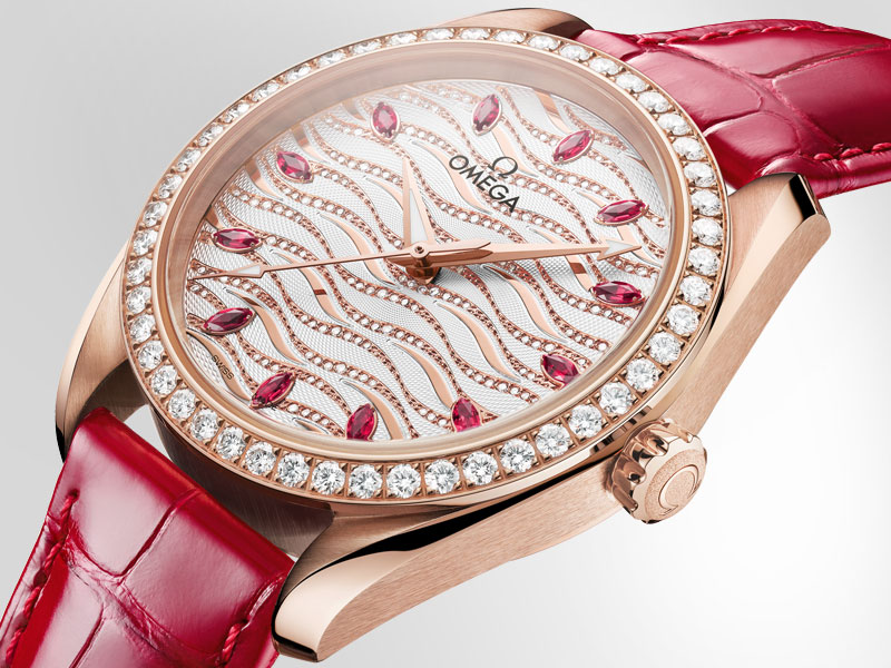 The glossy red leather strap accentuates with the color of the rubies.