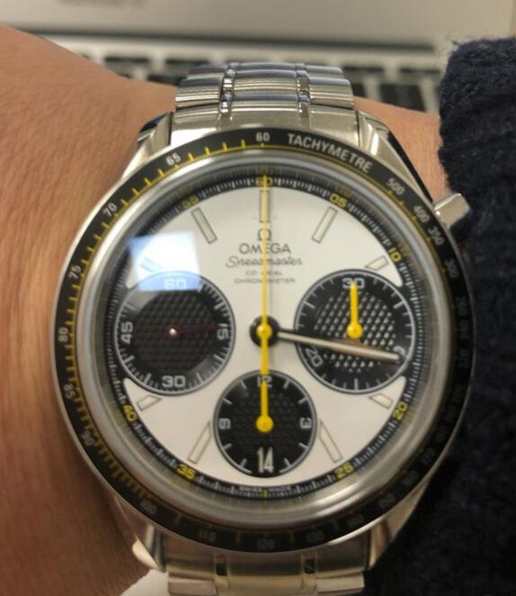 The yellow hands are really striking on the white dial.