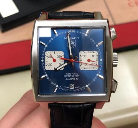 The red hands are striking on the blue dial.