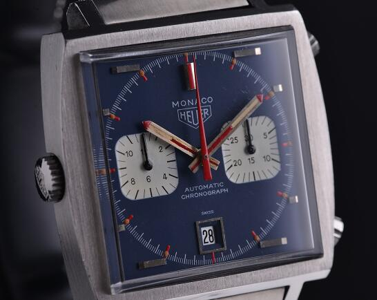 The red hands are in contrast to the blue dial.