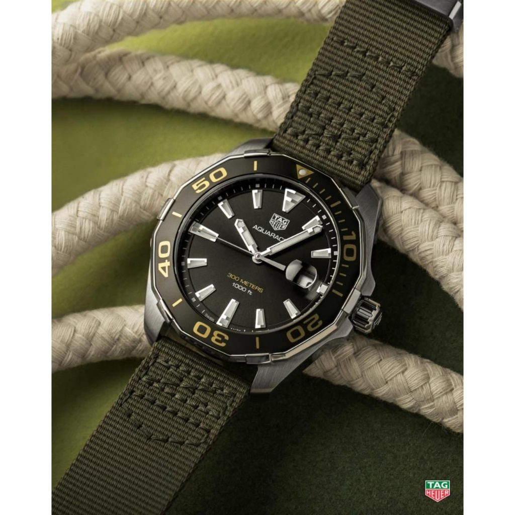 The male fake watch has Khaki green strap.